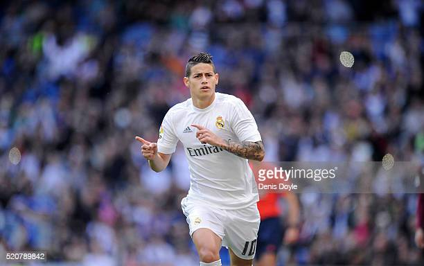 James Rodriguez of Real Madrid celebrates scoring his sid's opening goal during the La Liga match between Real Madrid and Eibar at Estadio Santiago...
