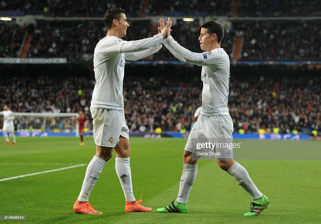 James Rodriguez (R) of Real Madrid celebrates scoring his team's second goal with Cristiano Ronaldo during the UEFA Champions League Round of 16 Second Leg match between Real Madrid and Roma at Estadio Santiago Bernabeu on March 8, 2016 in Madrid, Spain.
