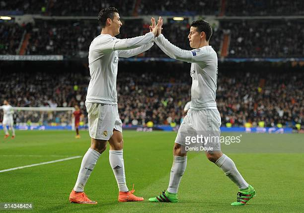 James Rodriguez of Real Madrid celebrates scoring his team's second goal with Cristiano Ronaldo during the UEFA Champions League Round of 16 Second...
