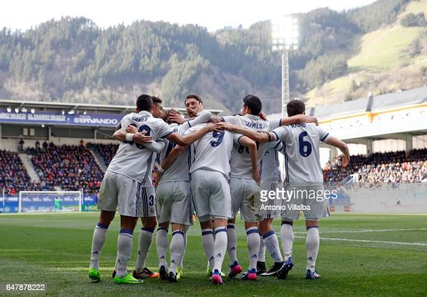 James Rodriguez of Real Madrid celebrates Whit teammates after scoring his team`s third goal during the La Liga match between SD Eibar and Real...