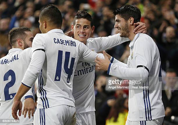 James Rodriguez of Real Madrid celebrates with Alvaro Morata and Casemiro after scoring the opening goal during the Copa del Rey round of 16 first...