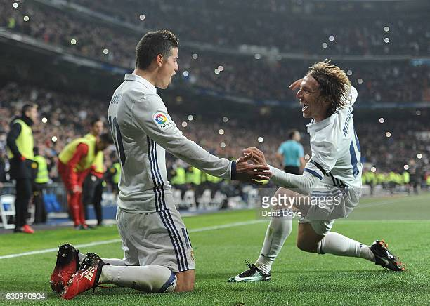 James Rodriguez of Real Madrid celebrates with Luka Modric after scoring Real's 3rd goal during the Copa del Rey Round of 16 First Leg match between...