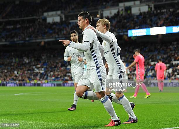 James Rodriguez of Real Madrid celebrates with Martin Odegaard after scoring Real's 2nd goal during the Copa del Rey last of 32 match between Real...