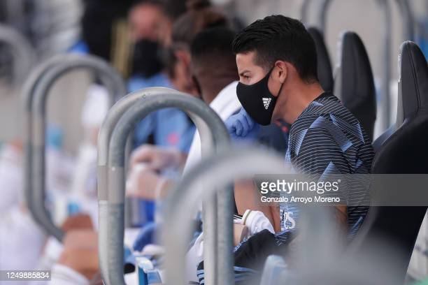 James Rodriguez of Real Madrid CF adjusts his mask from the bench during the Liga match between Real Madrid CF and SD Eibar SAD at Estadio Alfredo Di...