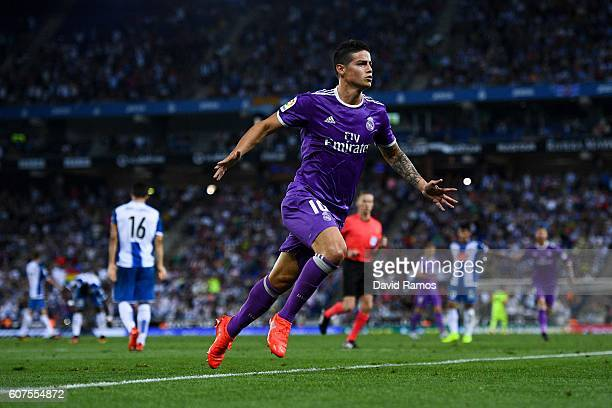 James Rodriguez of Real Madrid CF celebrates after scoring his team's first goal during the La Liga match between RCD Espanyol and Real Madrid CF at...