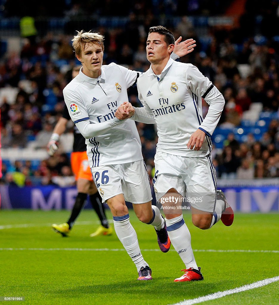James Rodriguez (R) of Real Madrid CF celebrates after scoring Real's 2nd goal whit is teammates Martin Odegard during the Copa del Rey last of 32 match between Real Madrid and Cultural Leonesa at estadio Santiago Bernabeu on November 30, 2016 in Madrid, Spain.
