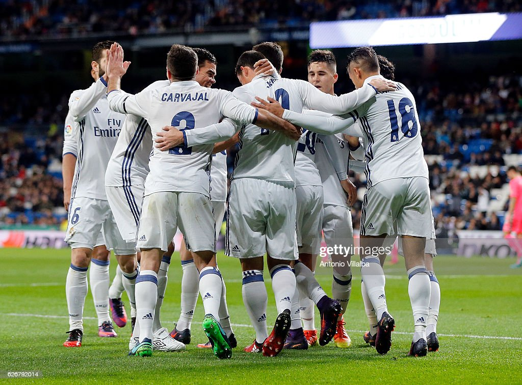 James Rodriguez (R) of Real Madrid CF celebrates after scoring Real's 2nd goal whit is teammates during the Copa del Rey last of 32 match between Real Madrid and Cultural Leonesa at estadio Santiago Bernabeu on November 30, 2016 in Madrid, Spain.