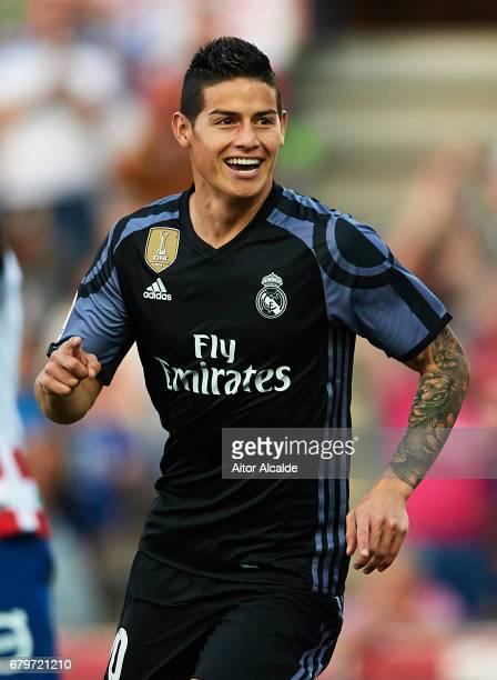 James Rodriguez of Real Madrid CF celebrates after scoring the first goal during the La Liga match between Granada CF v Real Madrid CF at Estadio...