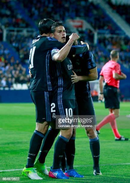 James Rodriguez of Real Madrid CF celebrates scoring their opening goal and Lucas Vazquez with teammates Alvaro Morata during the La Liga match...