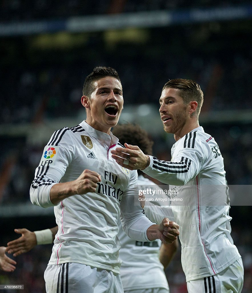 James Rodriguez (L) of Real Madrid CF celebrates scoring their second goal with teammate Sergio Ramos (R) during the La Liga match between Real Madrid CF and Malaga CF at Estadio Santiago Bernabeu on April 18, 2015 in Madrid, Spain.