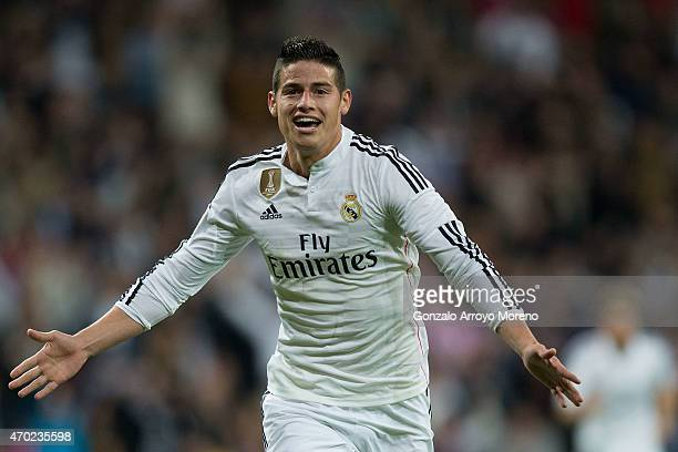 James Rodriguez of Real Madrid CF celebrates scoring their second goal during the La Liga match between Real Madrid CF and Malaga CF at Estadio...