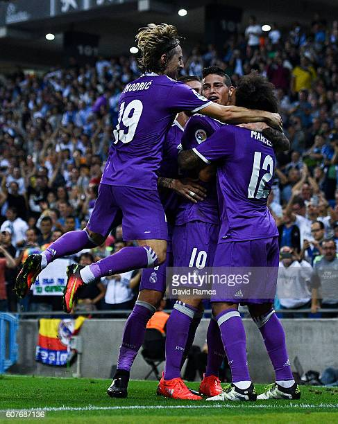 James Rodriguez of Real Madrid CF celebrates with his team mates after scoring his team's first goal during the La Liga match between RCD Espanyol...