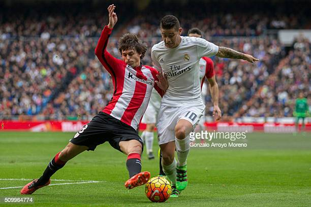 James Rodriguez of Real Madrid CF competes for the ball with Ander Iturraspe of Athletic Club during the La Liga match between Real Madrid CF and...