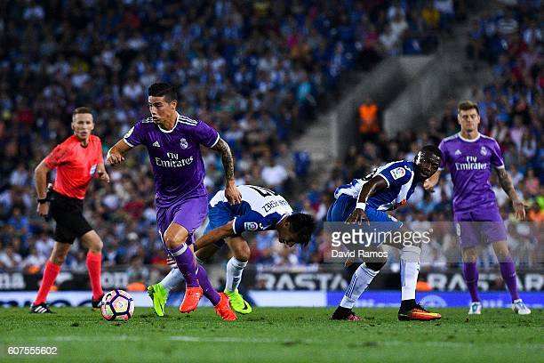 James Rodriguez of Real Madrid CF competes for the ball with Hernan Perez and Pape diopof RCD Espanyol on his way to score the opening goal during...