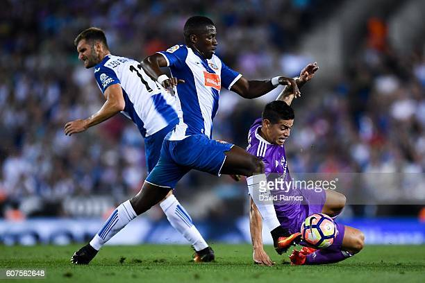 James Rodriguez of Real Madrid CF competes for the ball with Leo Baptistao and Pape Diop of RCD Espanyol during the La Liga match between RCD...