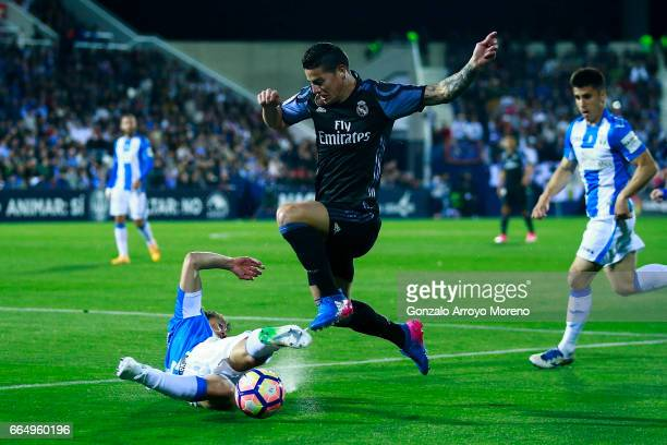 James Rodriguez of Real Madrid CF competes for the ball with Martin M Mantovani of Deportivo Leganes during the La Liga match between CD Leganes and...