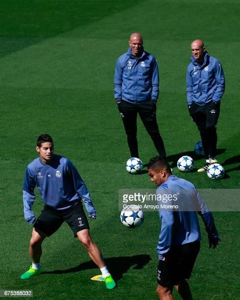 James Rodriguez of Real Madrid CF excersises with his teammate Carlos Casemiro ahead their coach Zinedine Zidane druing a training session ahead of...