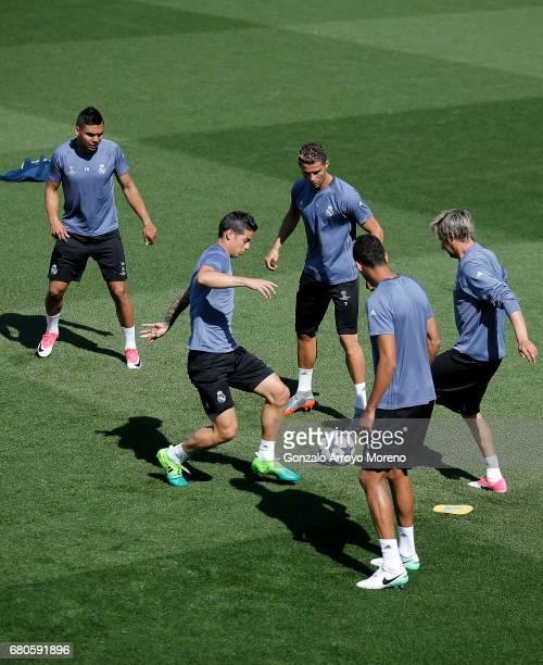 James Rodriguez of Real Madrid CF excersises with his teammates Cristiano Ronaldo Fabio Coentrao Danilo Luiz da Silva and Pepe during a training...
