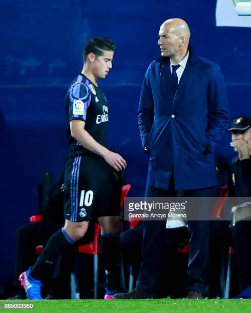 James Rodriguez of Real Madrid CF leaves the pitch behind his coach Zinedine Zidane during the La Liga match between CD Leganes and Real Madrid CF at...