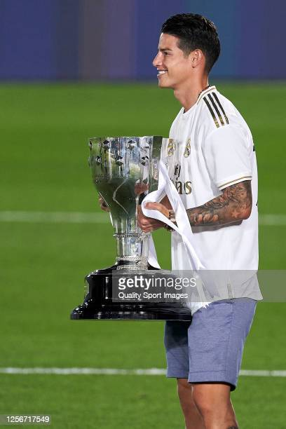 James Rodriguez of Real Madrid CF posing with the La Liga trophy after Real Madrid secure the La Liga title during the La Liga match between Real...