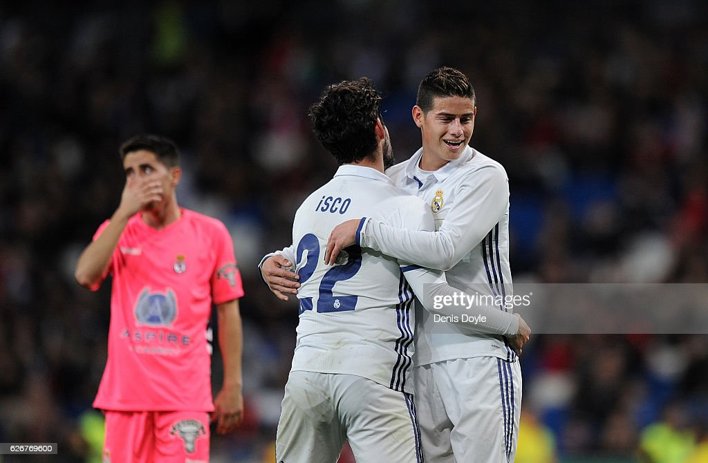 James Rodriguez of Real Madrid CF reacts with Isco after Isco narrowly failed to score a goal during the Copa del Rey last of 32 match between Real Madrid and Cultural Leonesa at estadio Santiago Bernabeu on November 30, 2016 in Madrid, Spain.