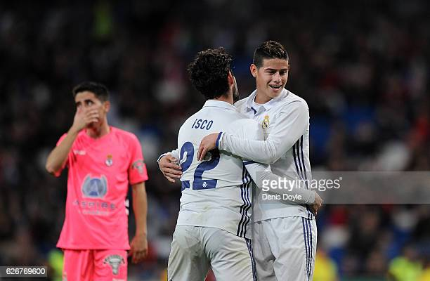 James Rodriguez of Real Madrid CF reacts with Isco after Isco narrowly failed to score a goal during the Copa del Rey last of 32 match between Real...