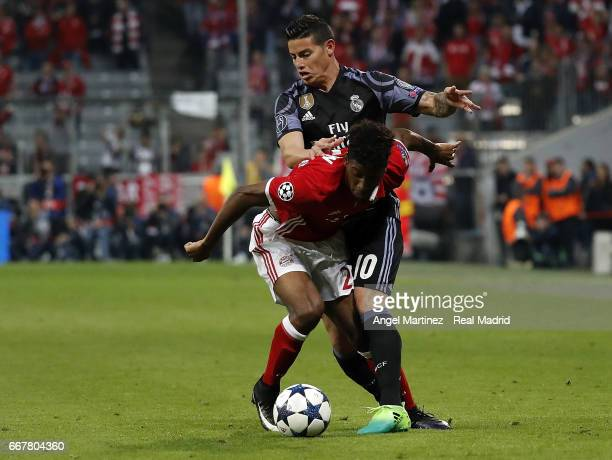 James Rodriguez of Real Madrid competes for the ball with David Alaba of FC Bayern Muenchen during the UEFA Champions League Quarter Final first leg...