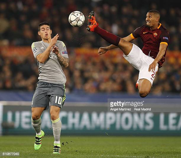 James Rodriguez of Real Madrid competes for the ball with William Vainqueur of AS Roma during the UEFA Champions League Round of 16 First Leg match...