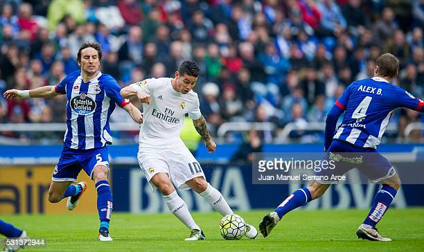 James Rodriguez of Real Madrid duels for the ball with Pedro Mosquera of RC Deportivo La Coruna during the La Liga match between RC Deportivo La...
