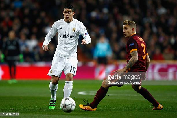 James Rodriguez of Real Madrid is closed down by Lucas Digne of Roma during the UEFA Champions League Round of 16 Second Leg match between Real...