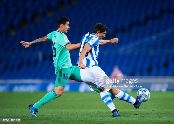 James Rodriguez of Real Madrid is tackled by Le Normand of Real Sociedad during the Liga match between Real Sociedad and Real Madrid CF at Estadio...