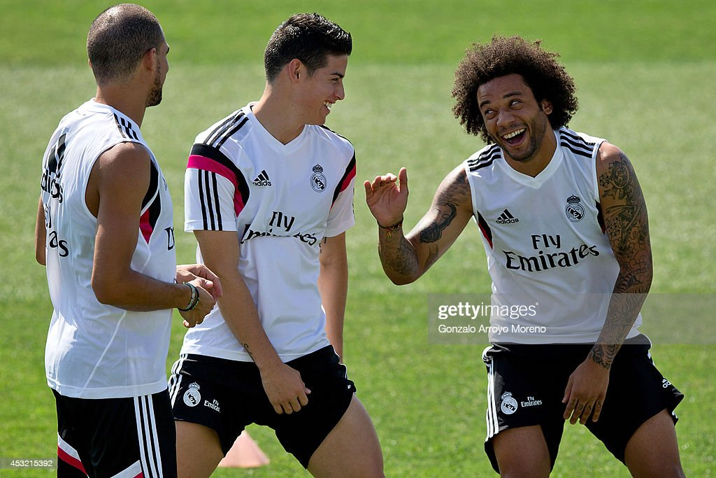 James Rodriguez (2nd L) of Real Madrid joks with team-mates Marcelo (R) and Karim Benzema (L) during a Real Madrid training session at Valdebebas training ground on August 5, 2014 in Madrid, Spain.