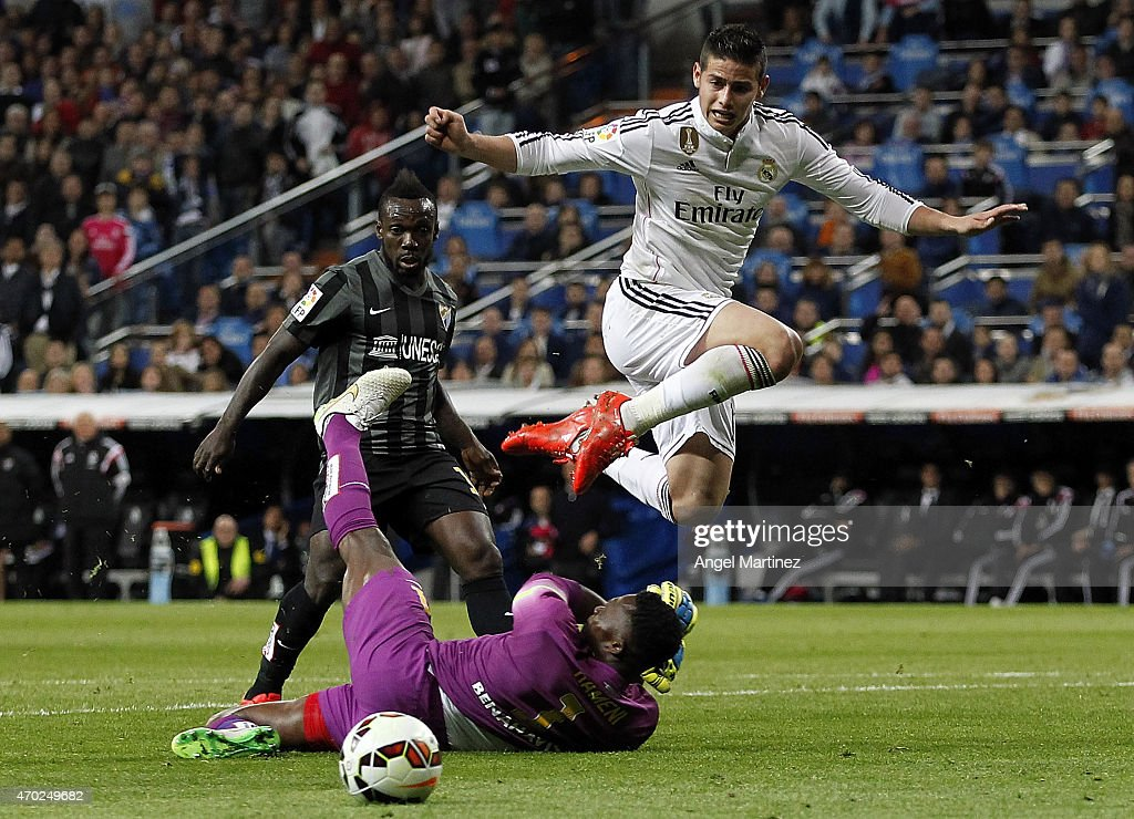James Rodriguez of Real Madrid jumps over Carlos Kameni of Malaga during the La Liga match between Real Madrid CF and Malaga at Estadio Santiago Bernabeu on April 18, 2015 in Madrid, Spain.