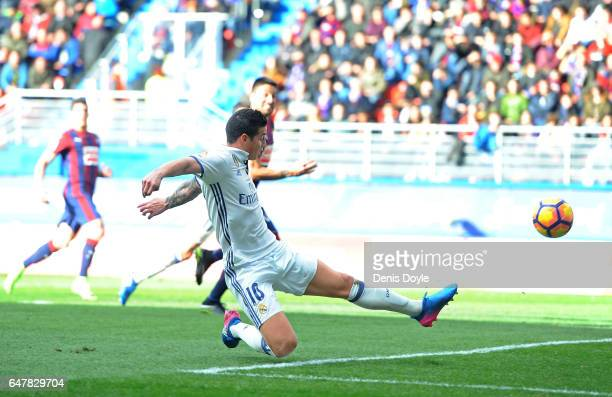James Rodriguez of Real Madrid of Real Madrid scores Real's 3rd goal during the La Liga match between SD Eibar and Real Madrid CF at Estadio...