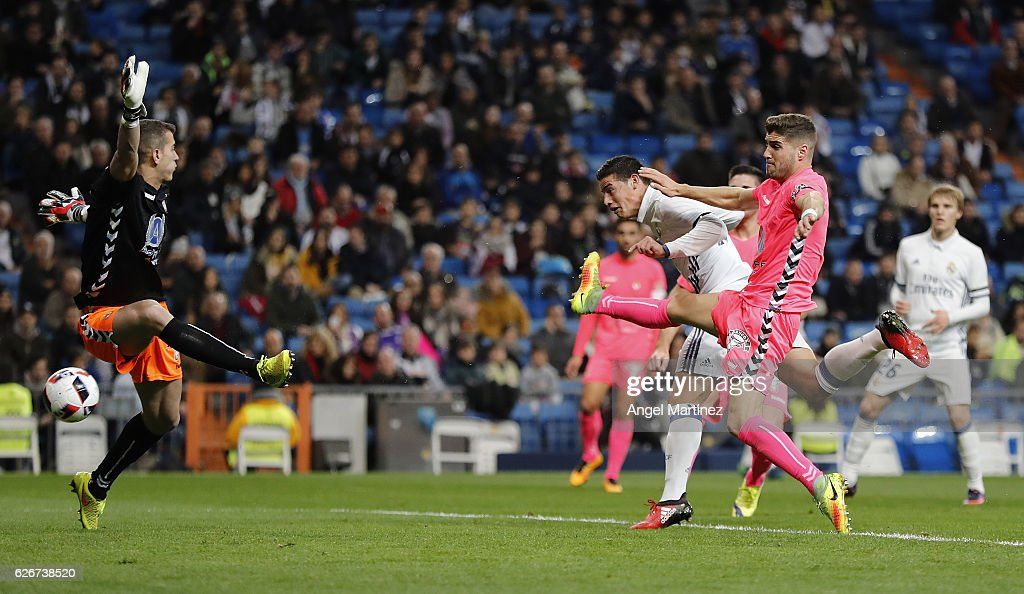 James Rodriguez of Real Madrid scores his team's second goal past Leandro Montagud of Cultural y Deportiva Leonesa during the Copa del Rey round of 32 second leg match between Real Madrid CF and Cultural y Deportiva Leonesa at Estadio Santiago Bernabeu on November 30, 2016 in Madrid, Spain.
