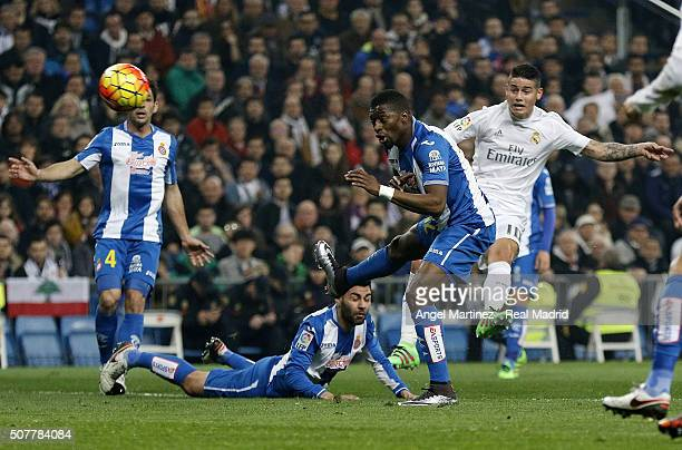 James Rodriguez of Real Madrid scores his team's third goal past Ruben Duarte and Pape Diop of Espanyol during the La Liga match between Real Madrid...