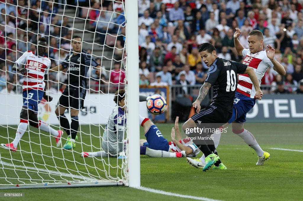James Rodriguez of Real Madrid scores the opening goal during the La Liga match between Granada CF and Real Madrid CF at Estadio Nuevo Los Carmenes on May 6, 2017 in Granada, Spain.