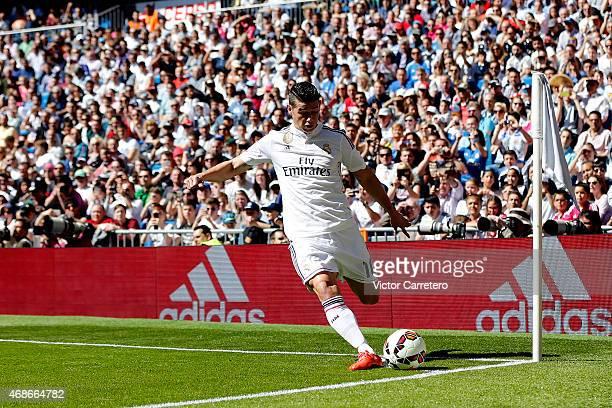 James Rodriguez of Real Madrid takes a corner kick during the La Liga match between Real Madrid CF and Granada CF at Estadio Santiago Bernabeu on...