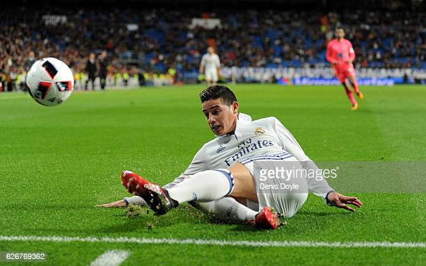 James Rodriguez of Real Madrid tries to keep the ball in play during the Copa del Rey last of 32 match between Real Madrid and Cultural Leonesa at...