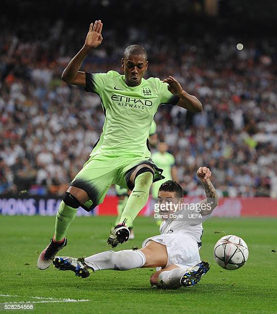 James Rodriguez of Real Madrid tries to shoot past Fernandinho of Manchester City during the UEFA Champions League Semi Final second leg match...