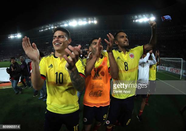 James Rodriguez Radamel Falcao and Abel Aguilar of Colombia celebrate the qualifying to the World Cup Russia 2018 after a match between Peru and...