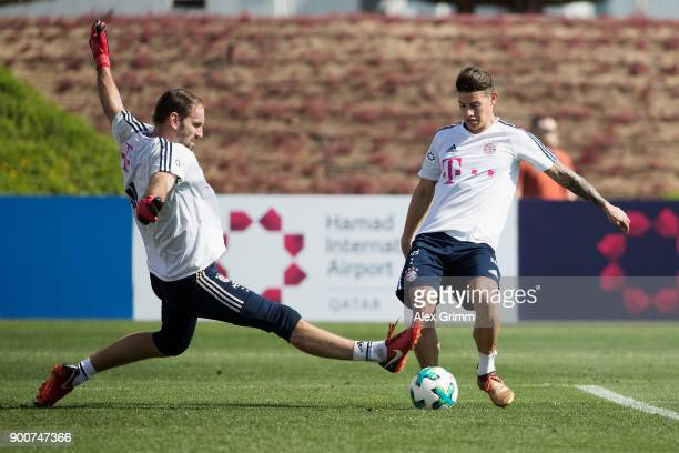 James Rodriguez scores a goal past goalkeeper Tom Starke during a training session on day 2 of the FC Bayern Muenchen training camp at ASPIRE Academy...