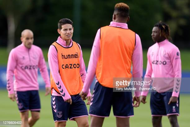 James Rodriguez speaks to Yerry Mina during the Everton Training Session at USM Finch Farm on September 24 2020 in Halewood, England.