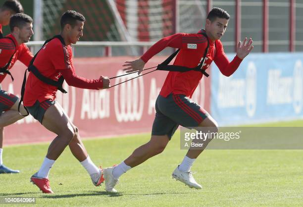 James Rodriguez Thiago and Robert Lewandowski of FC Bayern Muenchen practice during a training session at the club's Saebener Strasse training ground...