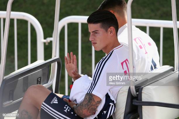 James Rodriguez waves as he leaves a training session on day 4 of the FC Bayern Muenchen training camp at ASPIRE Academy for Sports Excellence on...