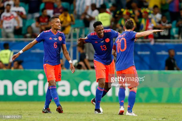 James Rodriguez Yerry Mina and William Tesillo of Colombia celebrates after winning the Copa America Brazil 2019 group B match between Argentina and...