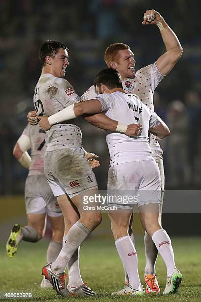 James Rodwell of England celebrates victory over South Africa with team mates Alex Gray and Jeff Williams during the Cup Final on day two of the...