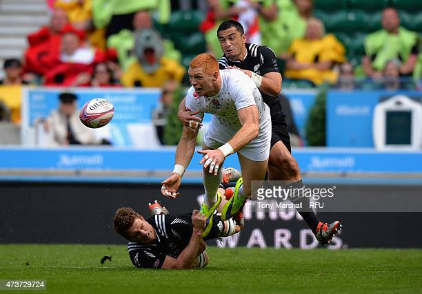 James Rodwell of England is tackled by Scott Curry and Sherwin Stowers of New Zealand during the Cup quarter final match match between New Zealand...
