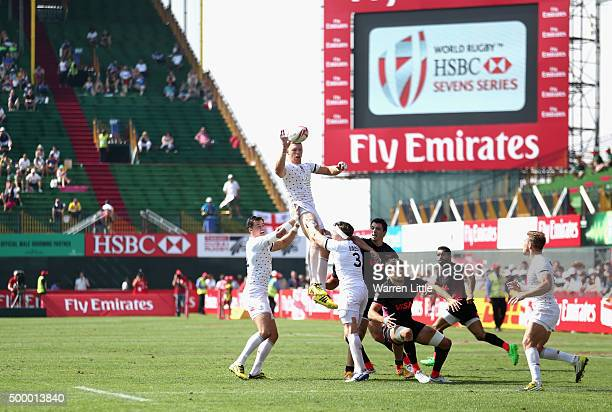 James Rodwell of England wins the line out ball in the Cup quarter final match against Argentina during the Emirates Dubai Rugby Sevens HSBC World...