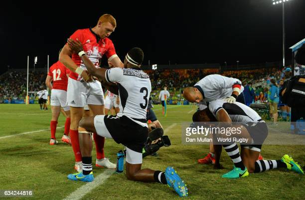 James Rodwell of Great Britain shakes hands with Semi Kunatani of Fiji following the Men's Rugby Sevens Gold Medal match between Fiji and Great...